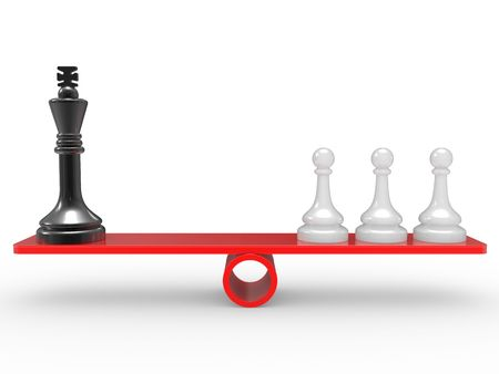 norm: Chessmen on scales. The rivalry concept Stock Photo