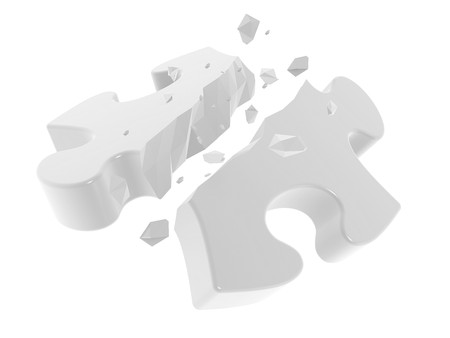 The broken puzzle on a white background photo