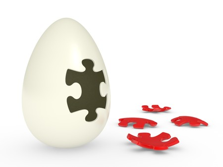 awaking: abstract egg with the puzzle cover Stock Photo