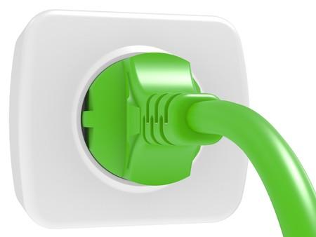 enchufe: enchufe eléctrico verde y toma de corriente aislada sobre fondo blanco  Foto de archivo