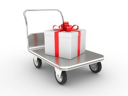 wheelbarrow with gift box on a white background photo