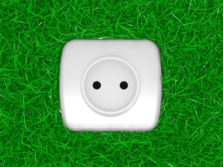 green energy concept, outlet on a grass photo