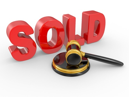 gold judge gavel and inscription sold on white background Stock Photo - 8737188