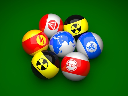 Billiard balls with danger signs and earth on a green background Stock Photo - 9249958