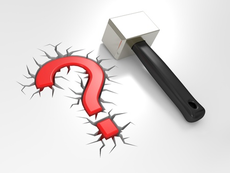Question sign and mallet on a white background photo