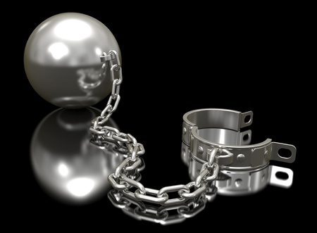 ball and chain: Steel ball on a chain and shackle on a black background