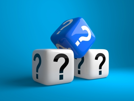 conceptual image: Cubes with question signs on a dark blue background Stock Photo