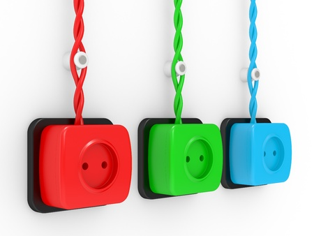 Electric sockets of different colours, red, dark blue and green photo