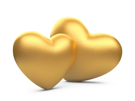 enamoured: two gold hearts isolated on a white background Stock Photo
