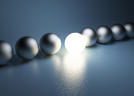 leadership abstract: bright glowing sphere in a row Stock Photo