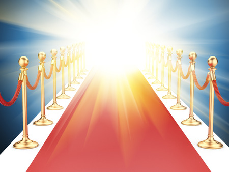 velvet rope barrier: red carpet between two gold stanchions with rope and flash light Stock Photo