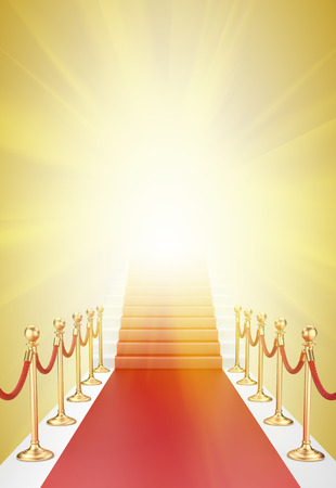 Staircase and red carpet between two gold stanchions with rope and flash light Stock Photo