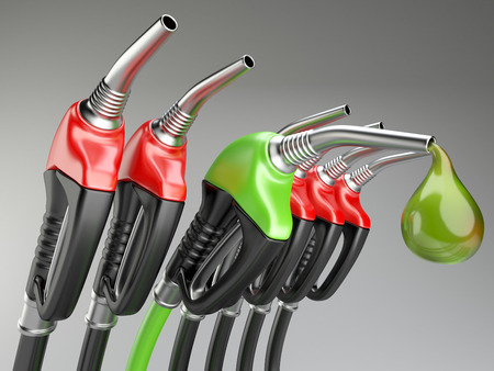 bio diesel: Red and green gas pump nozzle with drop oil.
