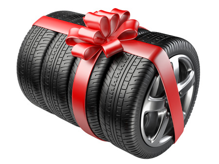 christmas bonus: Gift set tyres with a wrapped red ribbon and bow. 3D illustration  isolated on white background. Stock Photo