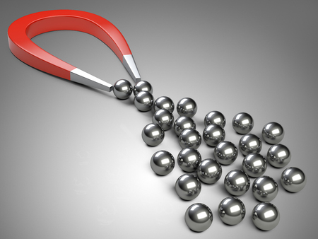 chrome ball: Big magnet attracting some chrome ball.  concept for marketing and business leadership
