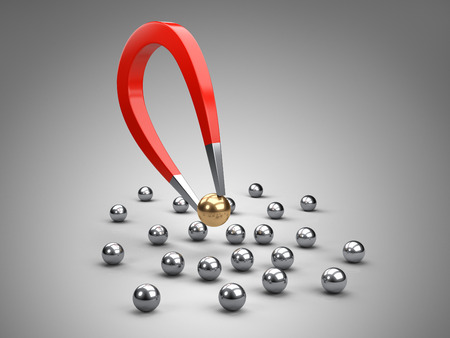 Magnet attracting gold ball.  concept for marketing and business leadership