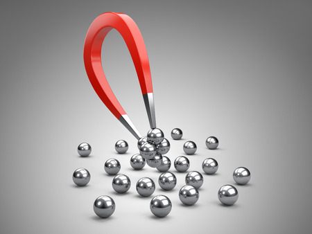 chrome ball: Magnet attracting some chrome ball.  concept for marketing and business leadership Stock Photo