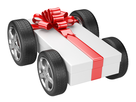 Gift box and a tyre wheels isolated on a white background