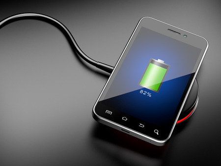 inductive: Wireless charging of smartphone. 3D image on a black background Stock Photo