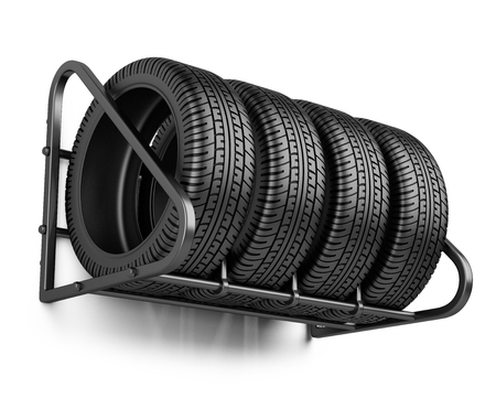 Tires set for sale at a tire store on the wall. 3d image isolated on a white background. Stock fotó