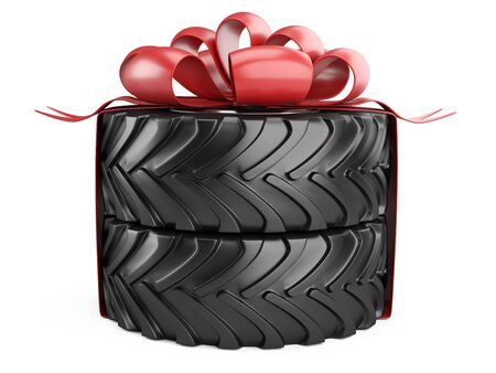 Big tire with red bow and ribons. Heavy equipment vehicle. Isolated 3d illustration on white background. 免版税图像