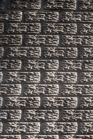 precast: A flat view of a section of concrete precast fencing in the form of a bricked wall Stock Photo
