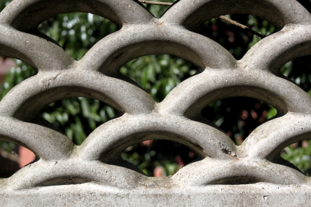 precast: A flat view of a detailed section of concrete precast fencing made out of arches Stock Photo