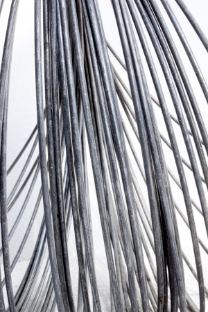 An Abstract Studio Shot Of A Coil Of Unravelling Thick Metal ...