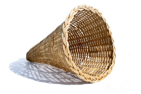 cone shaped: An perspective view of a cone shaped woven wicker basket on an isolated background