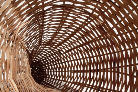 cone shaped: An abstract closeup perspective view of a cone shaped woven wicker basket on an isolated background Stock Photo