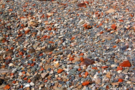 sone: An abstract collection of grey stones interspersed  with red clay brick pieces Stock Photo