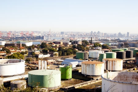 mass storage: An urban industrial landscape with residences mass storage tanks harbour and city