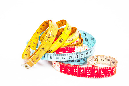 centimetres: Three colorful intertwined tape measures