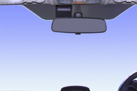 Framed view of sky from interior of vehicle showing rear-view mirror photo