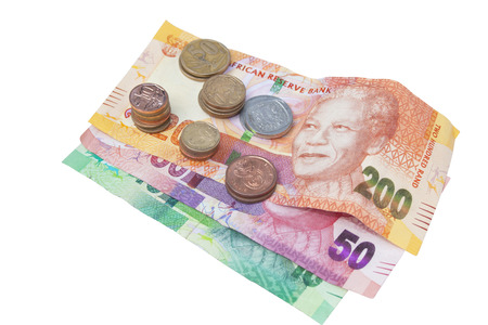 coins shot in golden color: Stacks of coins on three South African Bank Notes