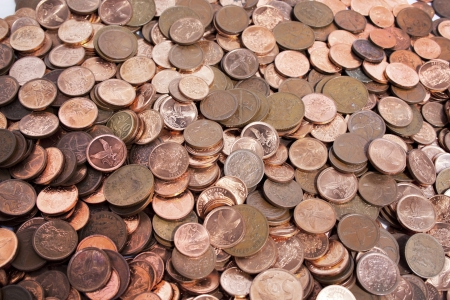 coins shot in golden color: Scattered collection of south african coins of small currency