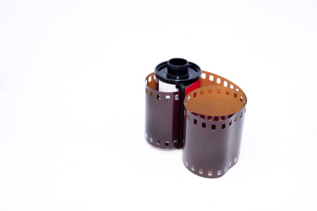 casing: Roll of 35mm photographic film extending from casing