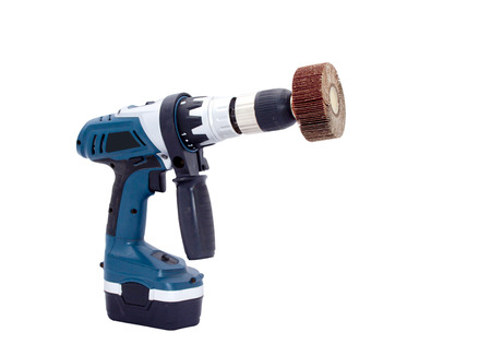 angled view: Right side angled view of battery powered drilling machine and sanding flap wheel Stock Photo
