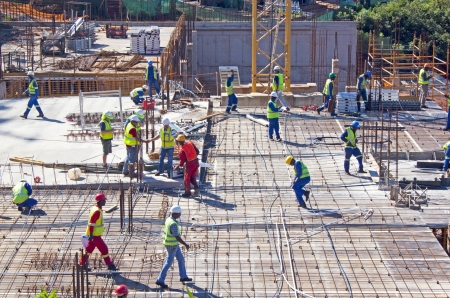 DURBAN, SOUTH AFRICA-NOVEMBER 2 2013: Twenty one workmen and management team working on construction site at Umhlanga Ridge on November 2 2013 in Durban South Africa