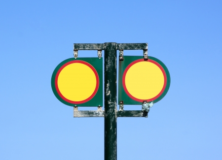 cautionary: twin isolated blank red and yellow cautionary signs with copyspace an blue sky background