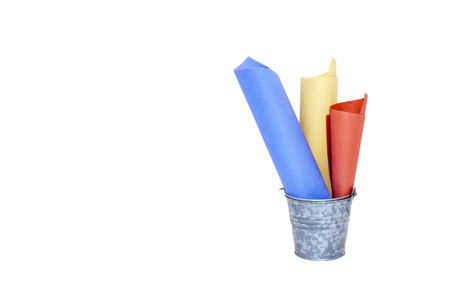 galvanised: galvanised bucket containing three rolled colored paper lists
