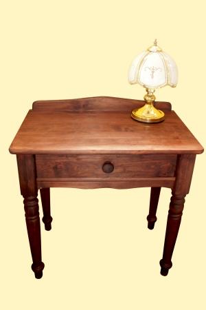 ornate classic bass lamp on bedside dresser photo