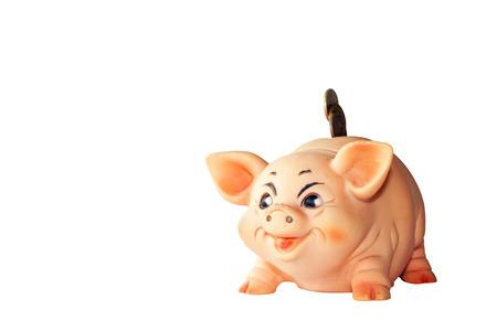 piggie bank: copper coins falling into piggy bank slot Stock Photo