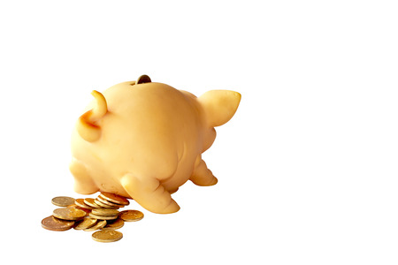 piggy bank with curly tail and copper coins Stock Photo
