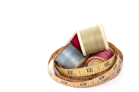vintage wooden reels of cotton and tape measure photo