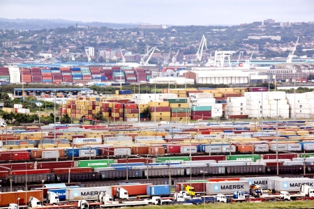 DURBAN, SOUTH AFRICA - DECEMBER 6 2013: Containers queued and stacked at Durban harbour entrance on December 6 2013 in Durban South Africa
