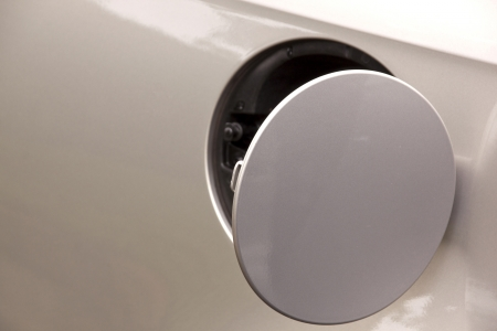 open gasoline cap cover on silver automobile photo