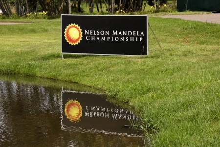 nelson mandela: DURBAN, SOUTH AFRICA - DECEMBER 14, 2013: Siigboard at edge of water hazard on ninth fairway at the Nelson Mandela Championship presented by ISPS Handa at Mount Edgecombe Golf Club on December reflection14 in Durban, South Africa.