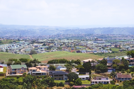 residential housing: above view of suburban residential housing estates with township