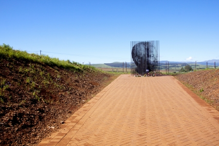 mandela: Howick, KwaZulu-Natal, South Africa - 30 December 2013: Metal sculpture of Nelson Mandela at the site where he was arrested in 1962 by the apartheid government.